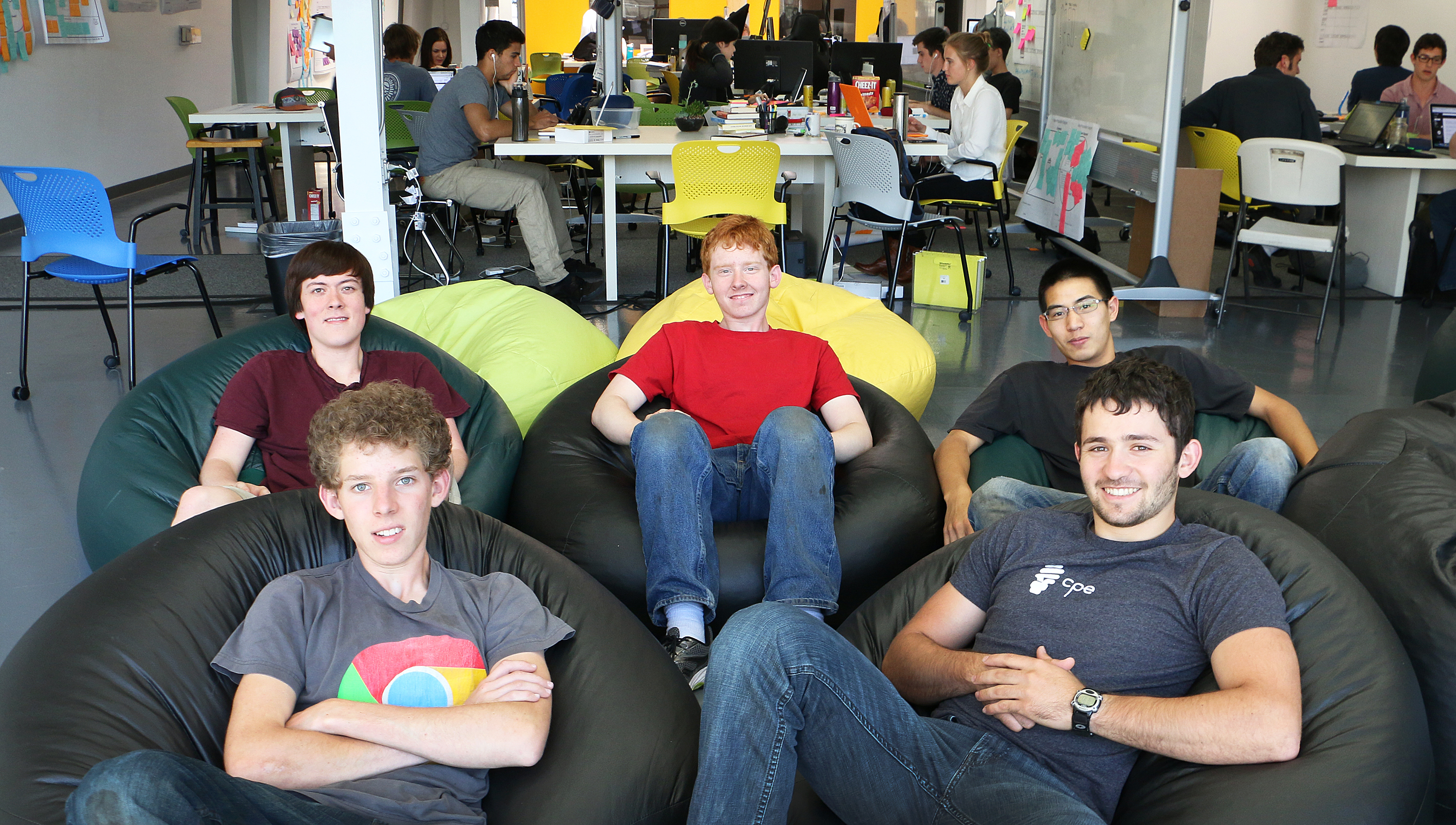 Mantis team sitting in bean bag chairs at the SLO HotHouse