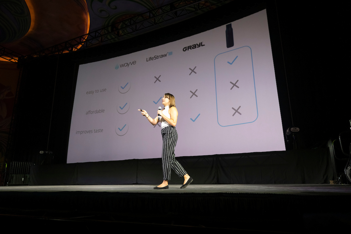 Sierra Scolaro pitching her startup idea on stage at Demo Day 2019..